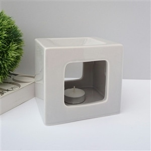 The elegant & stylish Cubic Grey Wax Burner as much home décor as they are functional warmers. Part of our very stylish wax melt burner range.